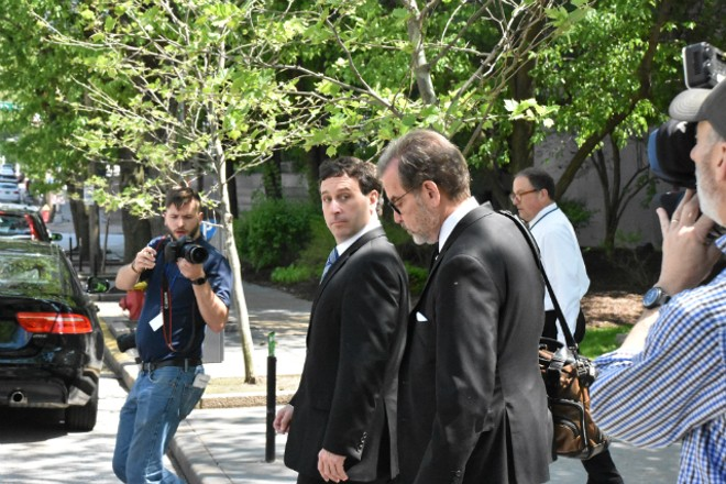 Steve Stenger (left) leaves the federal courthouse in April with his attorney, Scott Rosenblum. - DOYLE MURPHY
