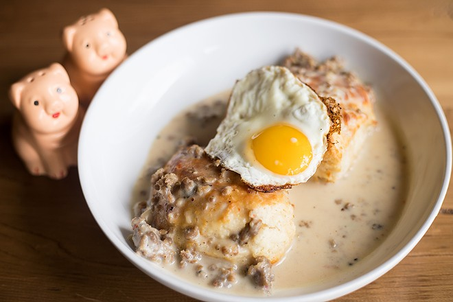 Housemade buttermilk biscuits is topped with housemade sausage gravy. - MABEL SUEN