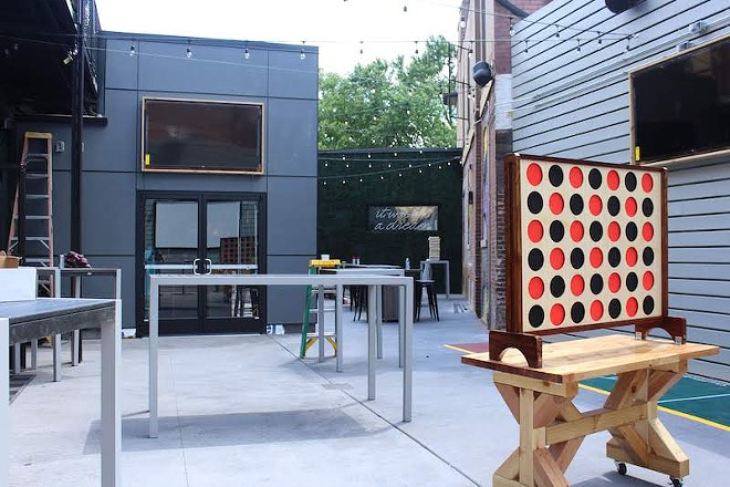 The newly created patio offers games including giant Connect 4. - KATIE COUNTS