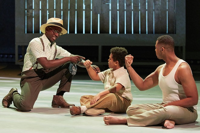 Jeremy Denis (center) and Davóne Tines (right), with Michael Redding, portray columnist Charles Blow at different stages of life. - ERIC WOOLSEY