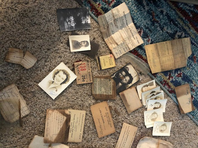 These items were found in wallets wedged into a brass vent cover behind a toilet in Centralia, Illinois. - COURTESY OF SETH BALTZELL