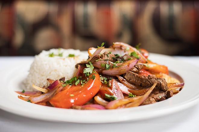 The lomo saltado features sauteed marinated tenderloin steak, red onions and tomatoes, served with french fries and rice. - MABEL SUEN