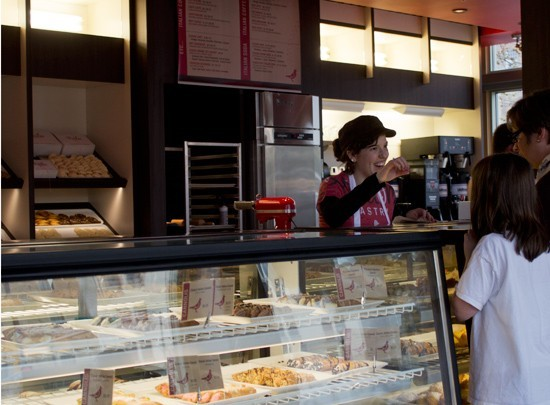 A worker greets customers at Piccione Pastry in 2013. - MABEL SUEN