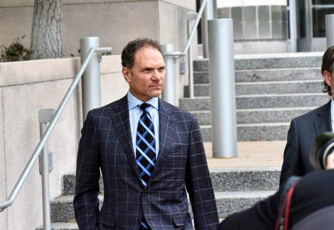 John Rallo went full power tie for his arraignment in May. - DOYLE MURPHY
