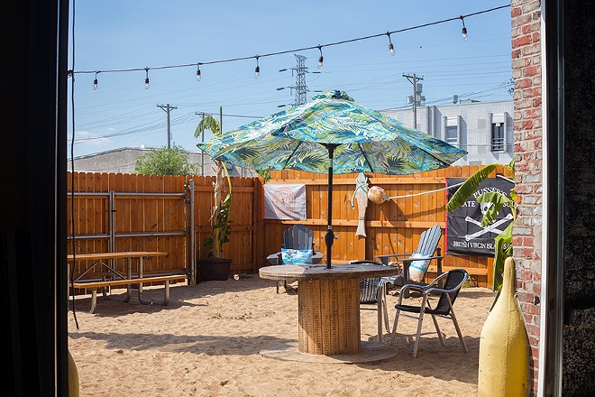 The back patio may be far from the Caribbean but still offers a beachy getaway to enjoy a vacation-style cocktail. - MABEL SUEN