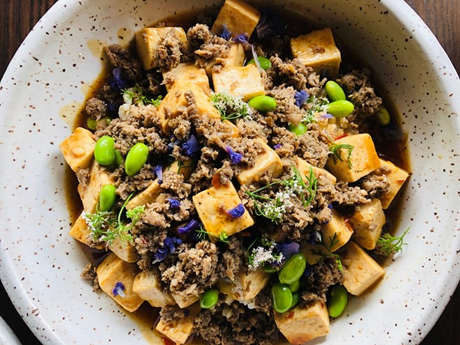 Ma po tofu is served with brown rice and quinoa. - COMPLIMENTS OF BERNIE LEE