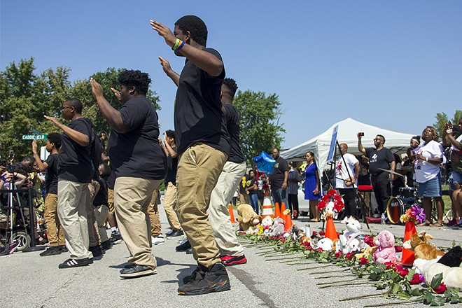 The step group Gentlemen of Vision performed next to the memorial for Michael Brown. - DANNY WICENTOWSKI