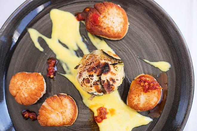 The capesante pairs pan-seared scallops with saffron cream, neonata and vegetal sfogliatella. - MABEL SUEN