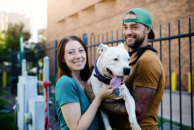 Visitors, such as Sara Isbell with Domino and Jake Wheeler, can use the park nine months out of the year. - STEPHEN KENNEDY