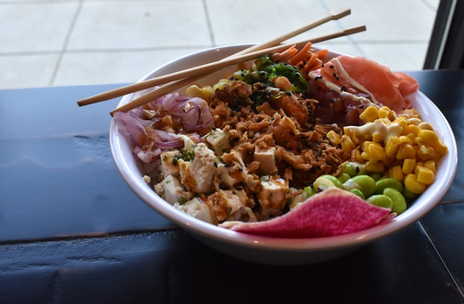 A build-your-own poke bowl with ahi tuna, herb tofu, spicy salmon, edamame, seaweed salad, ginger, red onion, pineapple, watermelon radish and corn. - LIZ MILLER