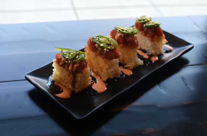 Spicy tuna crispy rice, a fried rice patty topped with spicy tuna, serrano chiles, eel sauce and spicy mayo. - LIZ MILLER