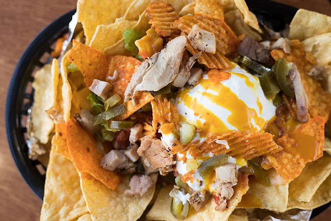 """The """"Uppercut"""" nachos come topped with chicken and turkey. - MABEL SUEN"""