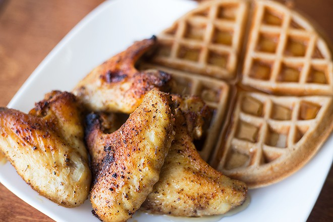 """The """"Pluck 'N' Waffles"""" plates three chicken wings atop a fluffy waffle. - MABEL SUEN"""