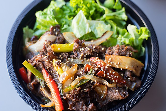 The beef bulgogi bowl features a subtly sweet, garlicky, soy-kissed mound of sliced beef. - MABEL SUEN