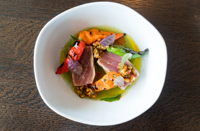 Big-eye tuna with habanada peppers, chile relish, annatto seed and cucumber jus. - COURTESY CINDER HOUSE AT FOUR SEASONS ST. LOUIS