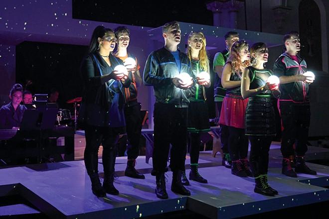 The ensemble and their glowing pinballs. - DAN DONOVAN
