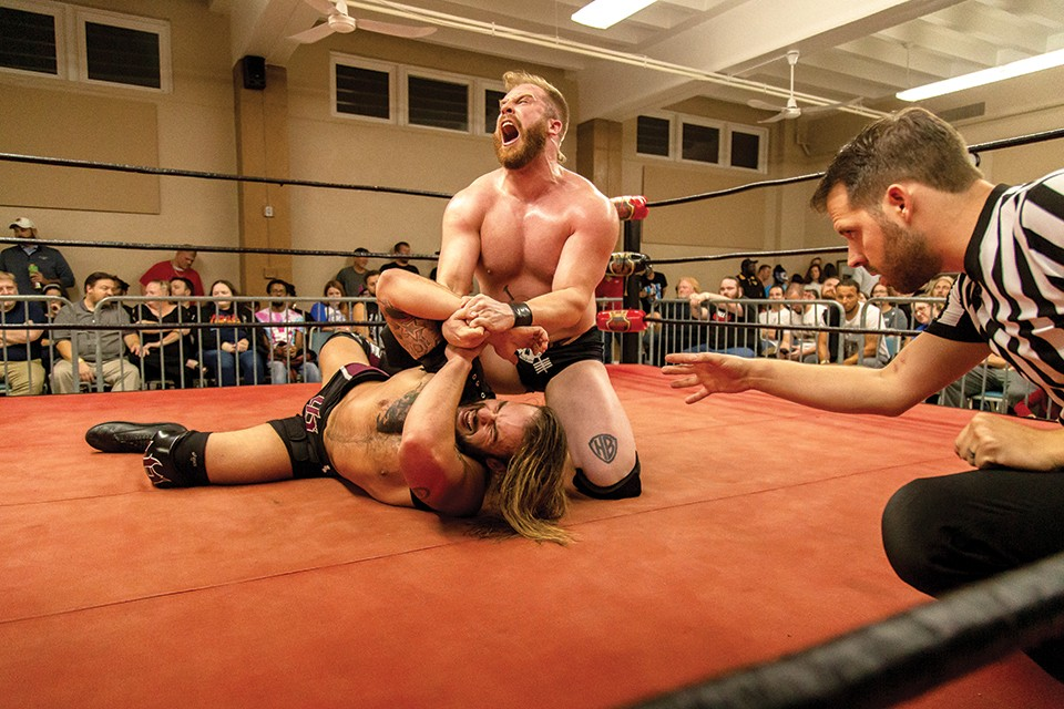 Josh Briggs (left) grapples on the ground with Tyler Colton. - MONICA MILEUR