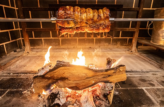 Many of BEAST Butcher & Block's brunch items are cooked over an open flame, such as the porchetta, a standout. - MABEL SUEN