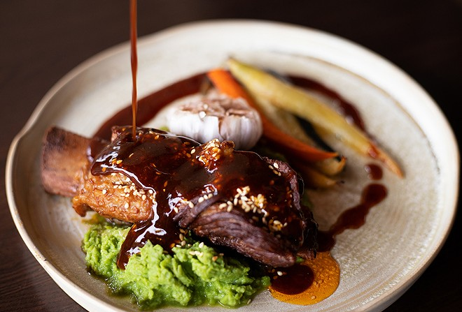 Like a perfectly cooked pot roast, the short rib meat falls away from the bone with barely the tug of your fork, leaving in its wake a pool of the mildly funky sambal jus. - MABEL SUEN