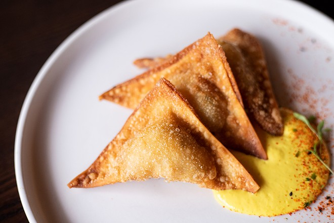 The lobster wonton reinvents the ubiquitous crab rangoon, subbing in lobster meat and a minimal dollop of cream cheese for the filling. - MABEL SUEN