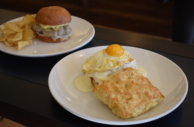 Buttermilk biscuit sandwich with a fried egg, applewood smoked ham, Cheddar and apple mustard. - LIZ MILLER