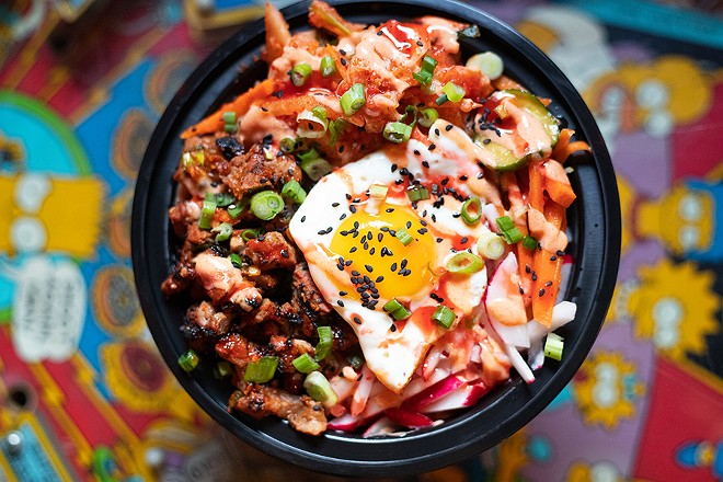 Tiny Chef's bulgogi steak bibimbap bowl with vegan kimchi, sesame seeds, cucumber-carrot-sesame salad, radishes, scallions, Japanese-style rice, a fried egg and Dragon and Pixie sauces. - MABEL SUEN