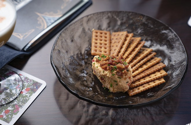 Whipped pimento spread with fried crackers, country ham cracklings, pepper and chives. - COURTESY OF LODGING HOSPITALITY MANAGEMENT