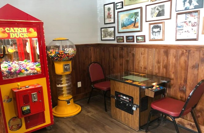 There's an old-school Catch a Duck claw game and retro Ms. Pac-Man game in the back of the dining room. - LIZ MILLER