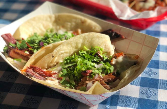 The brisket taco with burnt end-style brisket points,  smoked tomato jam, onion, queso, cilantro and J's Sauce. - LIZ MILLER