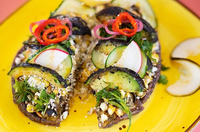 Huarache de maiz azul with black garlic, charred zucchini, beans, queso fresco, pepitas and charred avocado. - MABEL SUEN