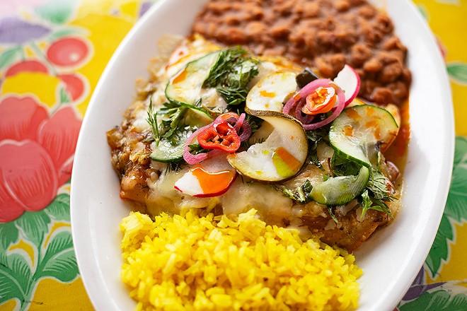 Enchiladas with chicken, corn tortillas, salsa verde, crema and cotija cheese. - MABEL SUEN