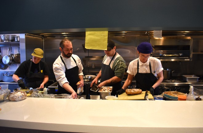 Chef-owner Craig Rivard (pictured second from left) working in the kitchen with his team. - LIZ MILLER