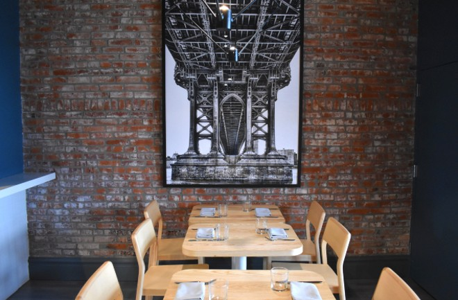 Artwork of the Brooklyn Bridge hangs in the dining room as an homage to the Rivards' history. - LIZ MILLER