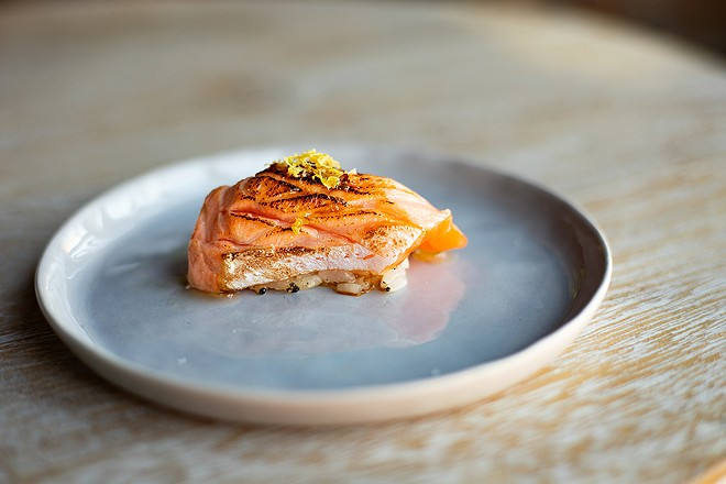 Benitoro serves seared salmon belly with lemon zest and a white soy sauce glaze. - MABEL SUEN