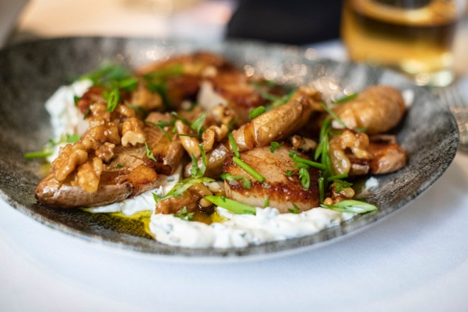 One of seven starters, the scallops and potato combined pan-seared scallops with crispy fingerling potatoes, sour cream, roasted walnut sauce and chives. - ED ALLER