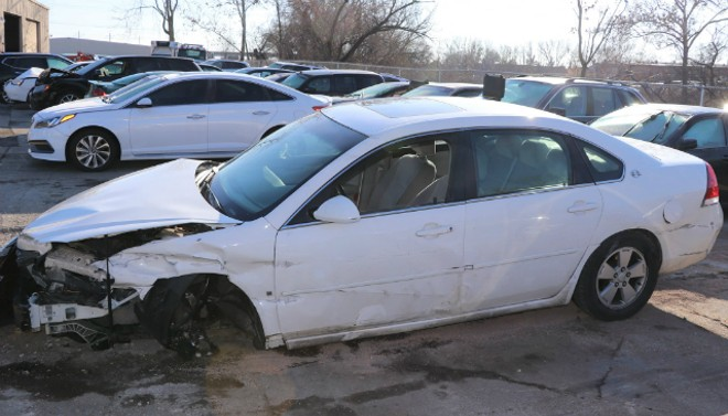 A stolen sedan was in bad shape following a collision with another stolen vehicle. - COURTESY CLAYTON POLICE