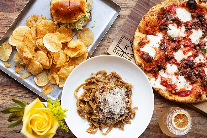 A selection of dishes from The Last Kitchen (pictured from left to right, top to bottom): pork chop sandwich, Grown Up Garlic Noodles and Salsiccia pizza. - MABEL SUEN
