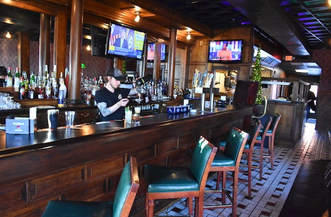 Kopsky mixes a cocktail behind the beautiful wood bar. - LIZ MILLER