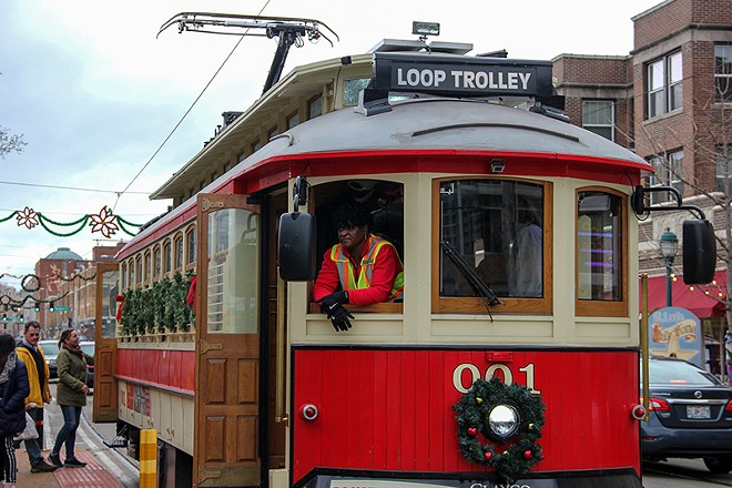 A worker on a packed Delmar Trolley on Sunday. - DANNY WICENTOWSKI