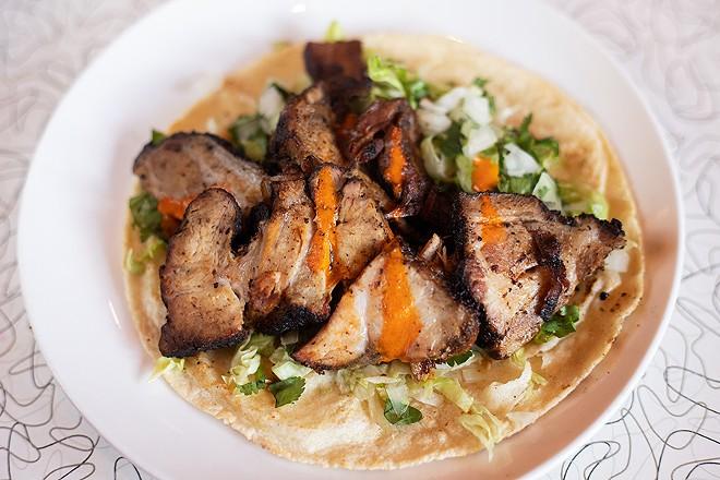 The Chippewa Taco with pork steak carnitas, lettuce, cilantro and onion on a corn tortilla. - MABEL SUEN