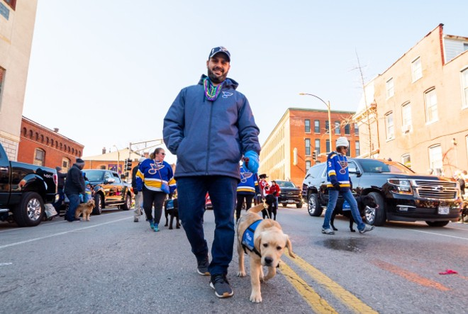 Randy Girsch, St. Louis Blues vice president of community partnerships, and Barclay. - COURTESY PURINA