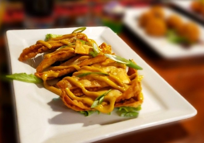 Cajun chicken and andouille wontons are one of Carnival's must-try shareable plates. - KRISTEN FARRAH