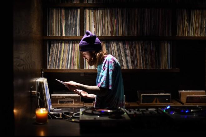 Takashima music director Paul Fullerton in the bar's DJ booth.