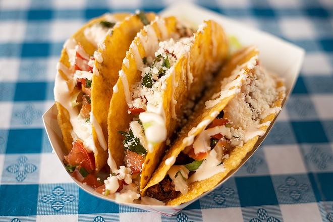 The Mom Taco with ground chuck, lime cabbage, pico de gallo and sour cream in a crispy corn tortilla. - MABEL SUEN