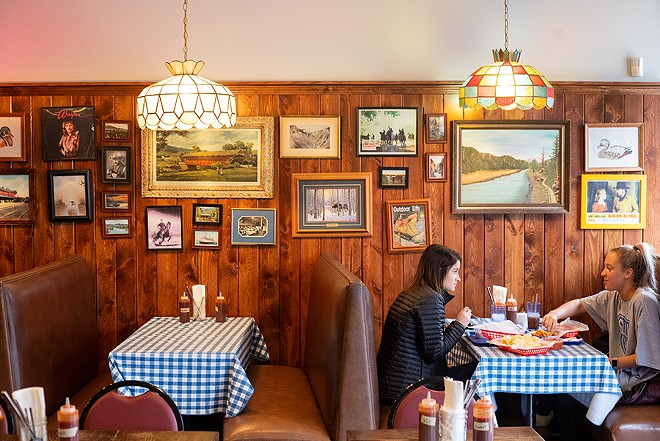 Vintage stained-glass chandeliers that appear fogged from years of smoke hang from the ceiling at Original J's, while framed pictures of waterfowl and Waylon Jennings decorate the dining room. - MABEL SUEN