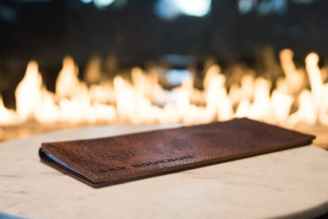 Bar Bourbon features a gorgeous fireplace. - TRENTON ALMGREN-DAVIS