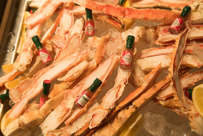 Crab legs served at the grand opening. - TRENTON ALMGREN-DAVIS