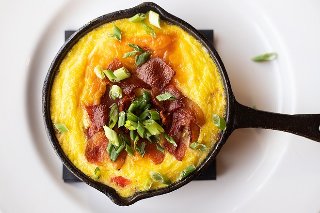 The skillet frittata with hash browns, eggs, cheddar cheese, roasted red peppers, caramelized onions and bacon. - MABEL SUEN