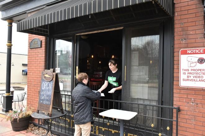 Three Monkeys co-owner Mary Rice helps a customer. - DOYLE MURPHY