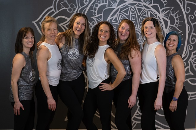 The team at Detox Yoga posed for a photo before social distancing went into place. - COURTESY APRIL ELLIOTT
